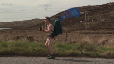 A man is embarking on a 2000-mile walk around the UK and Ireland in his swimming trunks.