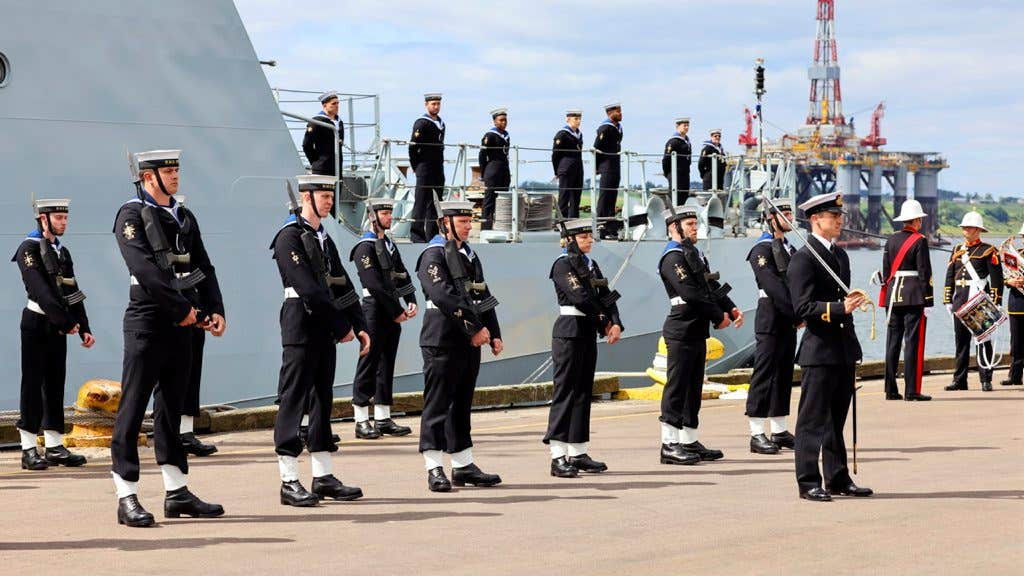 RAF submarine-hunting Poseidon aircraft from RAF Lossiemouth carried out a flypast and the Band of the Royal Marines Scotland played to mark the occasion.