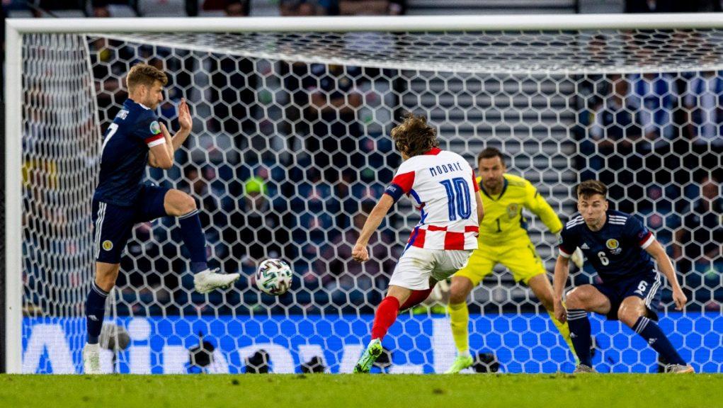 Modric curls Croatia's crucial second goal into the top corner.