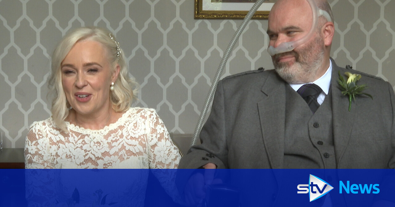 Man battling MND marries partner who has been by his side