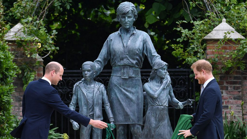 Prince William and Prince Harry unveil a statue they commissioned of their mother Diana.