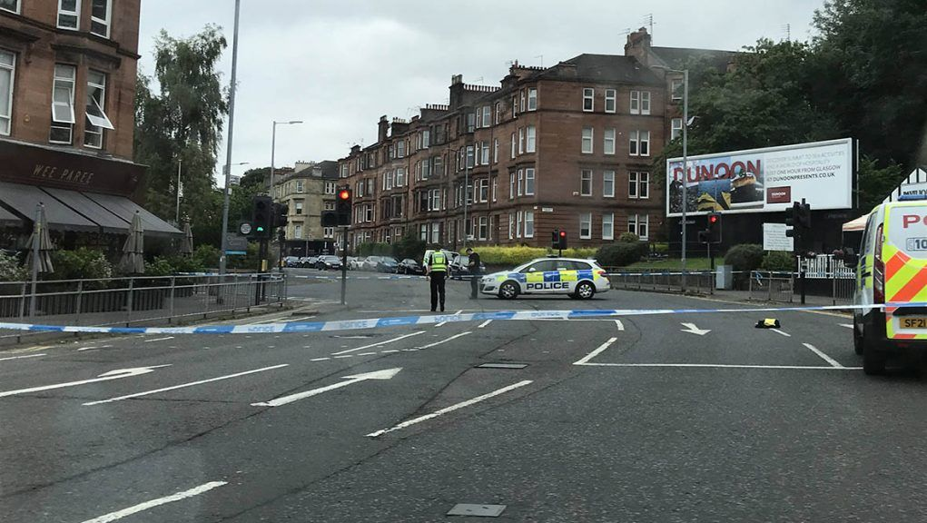 Police cordon in place on Glasgow's Crow Road at junction with Clarence Drive.