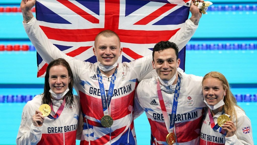 Champs: Great Britain's Kathleen Dawson, Adam Peaty, James Guy and Anna Hopkin with their gold medals.
