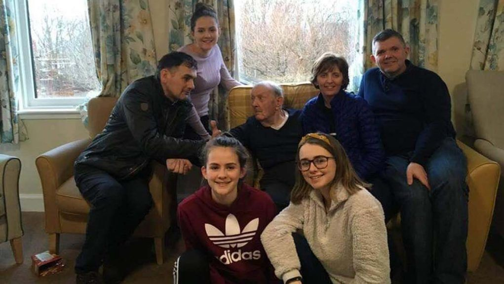 John Angus Gordon surrounded by his family at Home Farm care home.