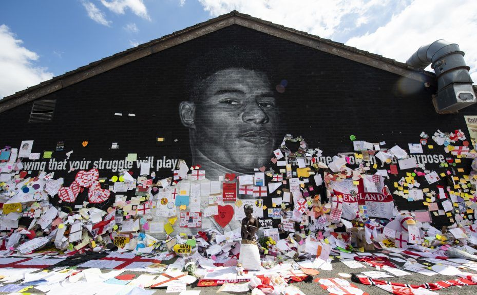 Tributes were left at a mural of England striker Marcus Rashford after it was defaced with racist abuse after the game.