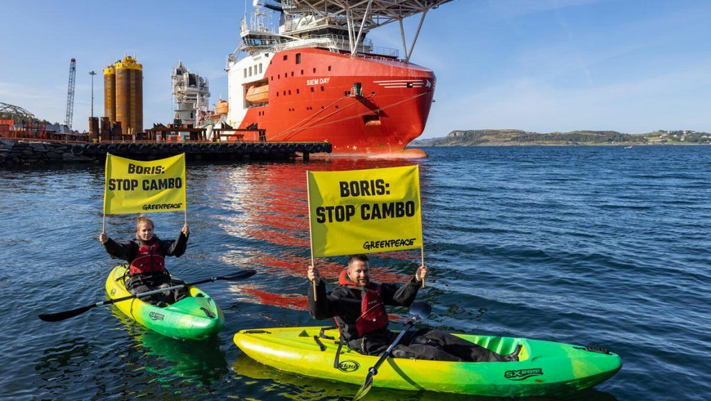 Greenpeace activists protesting next to Siem Day vessel in Norway.