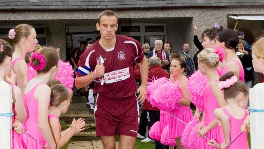 Linlithgow Rose captain Greg Denham is greeted by young cheerleaders as he runs out.