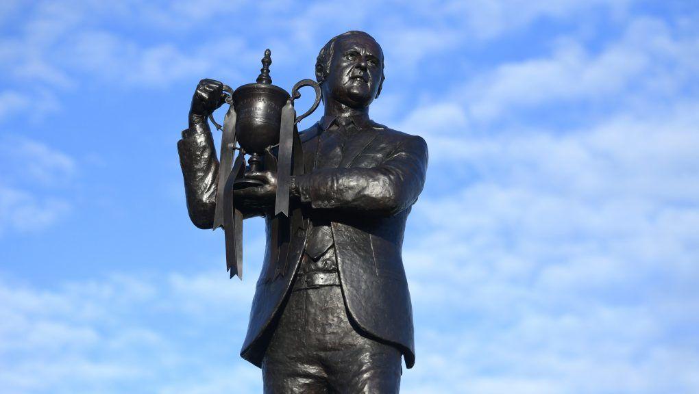 The statue of McLean show him holding the Premier League trophy.