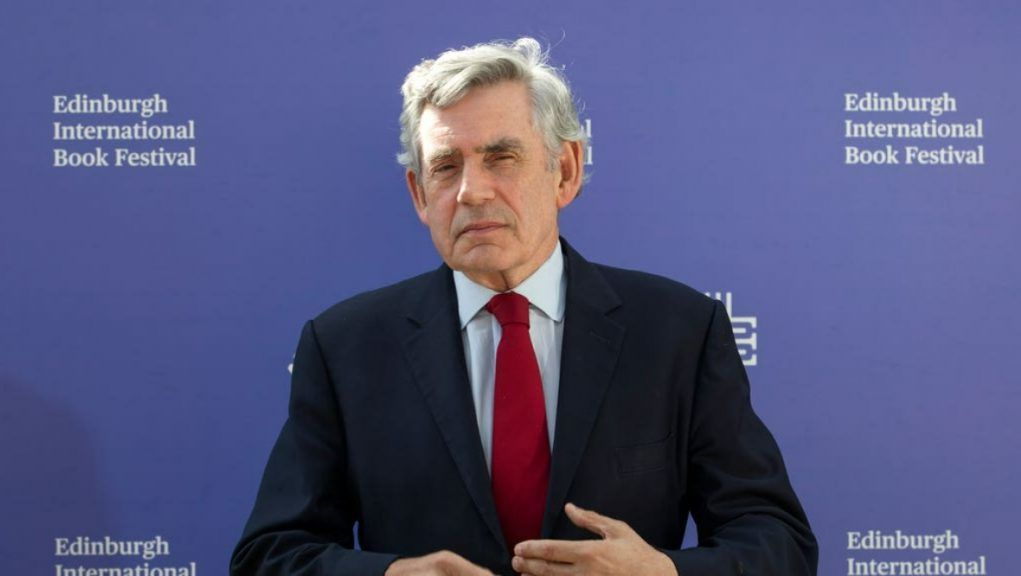 Vaccine: Gordon Brown said hundreds of millions of doses are lying in warehouses in Europe and North America.