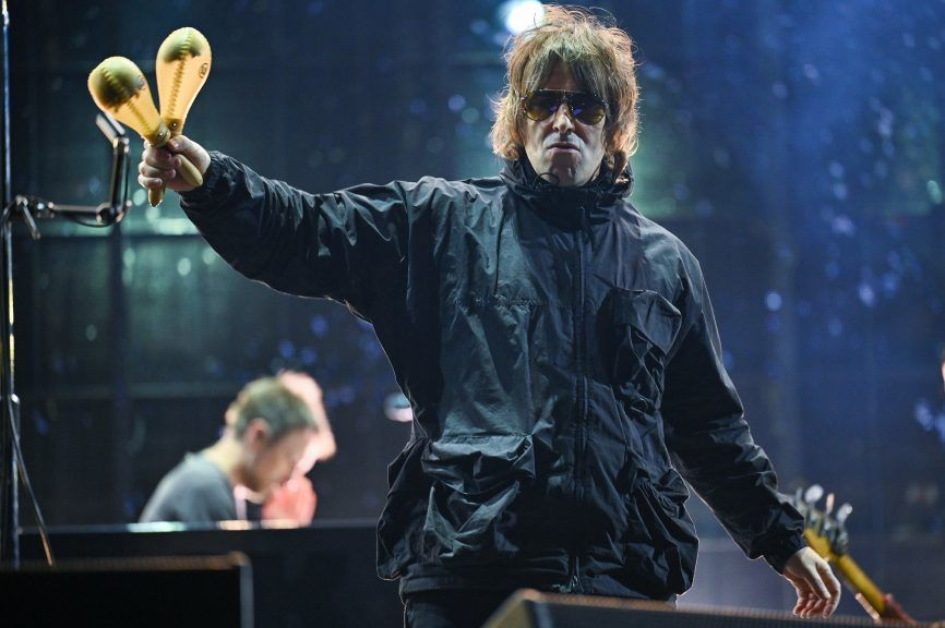 Liam Gallagher says he fell out of a helicopter after performing at the Isle of Wight festival.