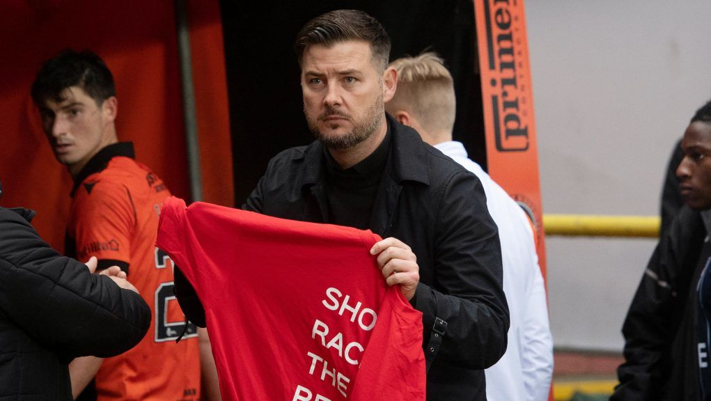 Courts approached Ross County fans holding up a Show Racism the Red Card t-shirt.
