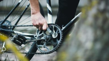 Stock image of a bicycle pedal and chain.
