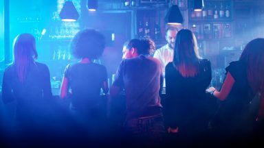 Stock image of people in a bar.