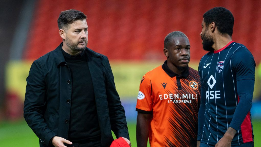 United boss Tam Courts approached away fans with a Show Racism The Red Card t-shirt.