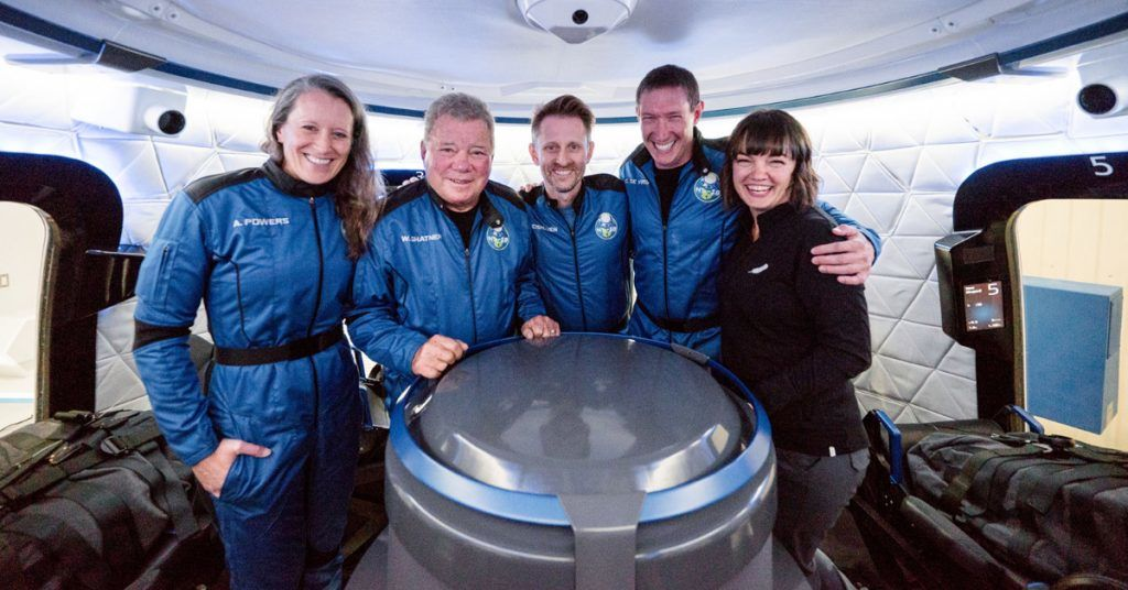 The crew of NS-18, Audrey Powers, William Shatner, Dr. Chris Boshuizen, and Glen de Vries, with CrewMember 7 Sarah Knights.