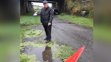 Councillor Andy Doig next to the smelly water hole in Kilbarchan.